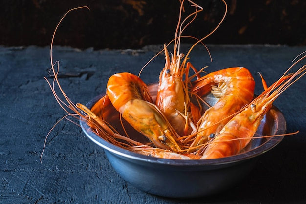 Seafood shrimp menu in a plate on a white table