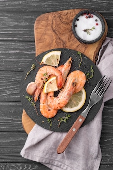 Seafood shrimp on wooden board and cutlery