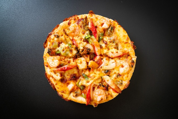 Seafood (shrimps, octopus, mussel and crab) pizza on wood tray