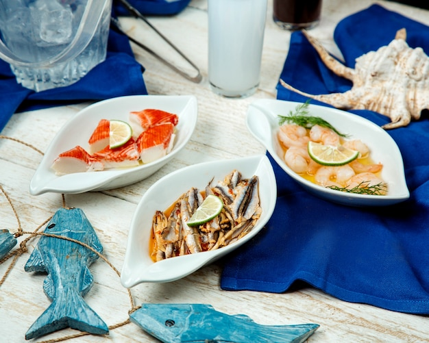 Seafood side dishes with platter of shrimp, squids and fish