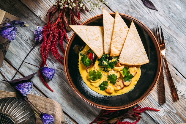 Seafood yellow cream soup with pita bread