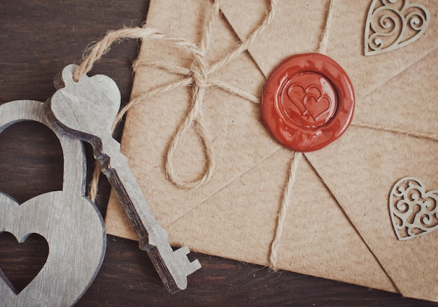 Sealed love letter on a wooden background