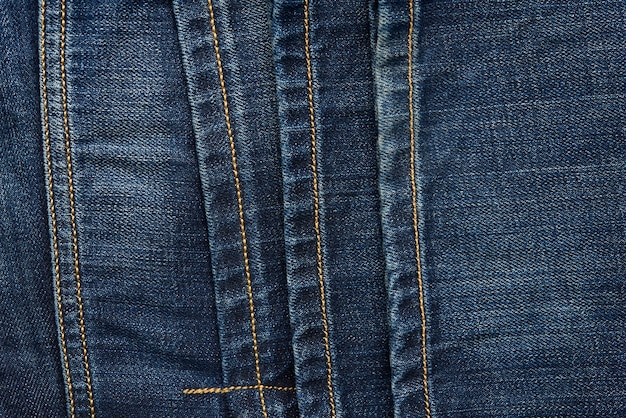 Seam on blue jeans with brown thread