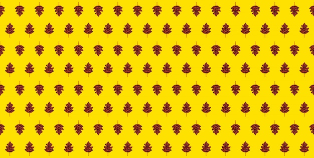 Seamless autumn pattern-yellow background with autumn leaves made of knitted scarf.