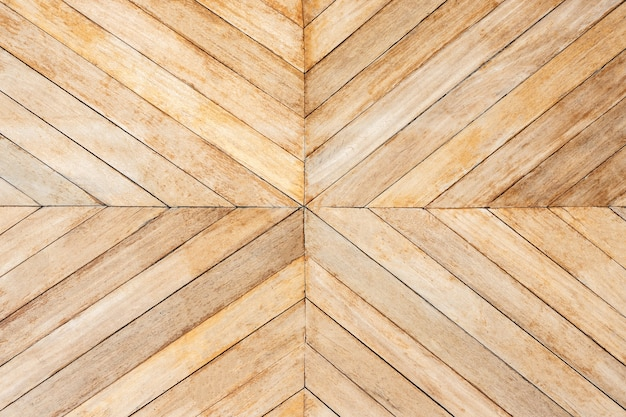 Seamless brown color lumber in arrows or chevron pattern to the center. top view