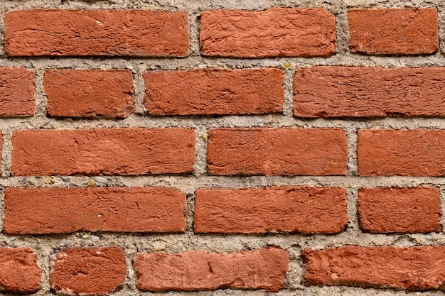 シームレスな濃い赤レンガの壁のテクスチャ背景