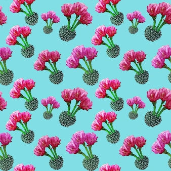 Seamless floral summer tropical pattern background with blooming cactuses, succulents on turquoise background.