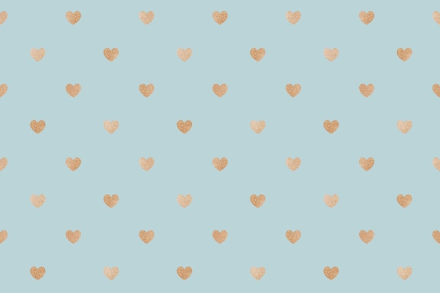 Seamless glittery gold hearts patterned background Free Photo