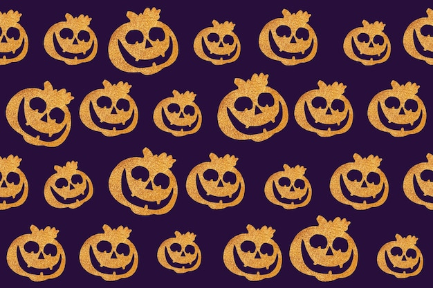 シームレスなハロウィーンのパターン。濃い紫色の背景にカボチャの顔。