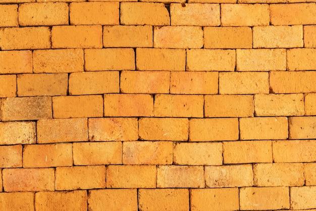 원활한 주황색 벽돌 벽 배경입니다.