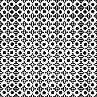 シームレスに整理された黒い点の抽象的な背景