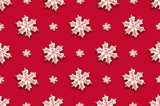 Seamless pattern of christmas gingerbread in shape snowflakes on red background. xmas background.