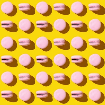 Seamless pattern of colorful french cookies macarons