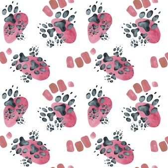 Seamless pattern of dog footprints on pink spots. watercolor illustration.