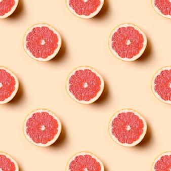 Seamless pattern of grapefruit slice on beige.