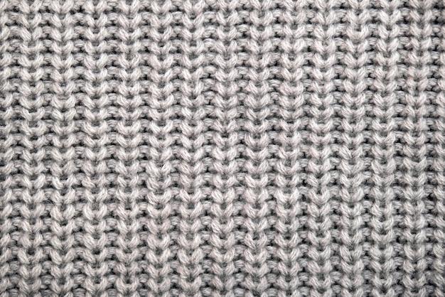 Seamless pattern of knitted warm winter sweater