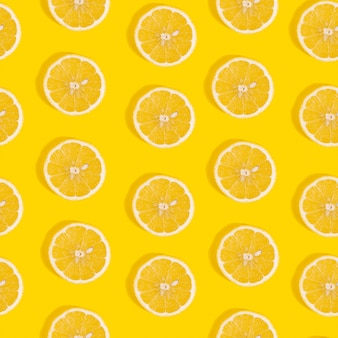 Seamless pattern of lemon on yellow background.