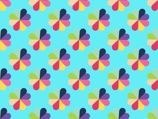 파란색 표면에 다채로운 스폰지 꽃의 완벽 한 패턴