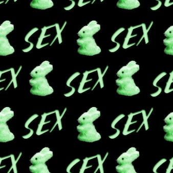 Бесшовный фон из кроликов со словом секс, изолированные на черном фоне. фото высокого качества