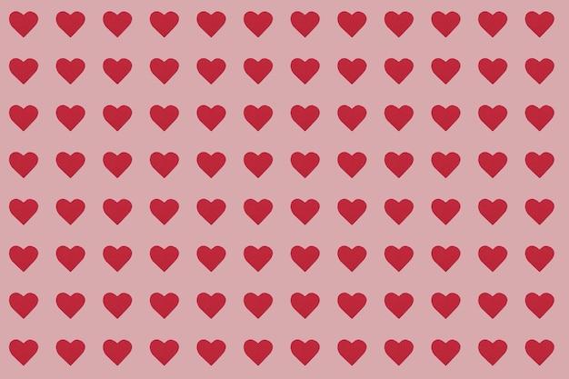 ピンクの背景に赤いハートのシームレスなパターン。上面図。バレンタインデーのコンセプト。愛とロマンチックなコンセプト。