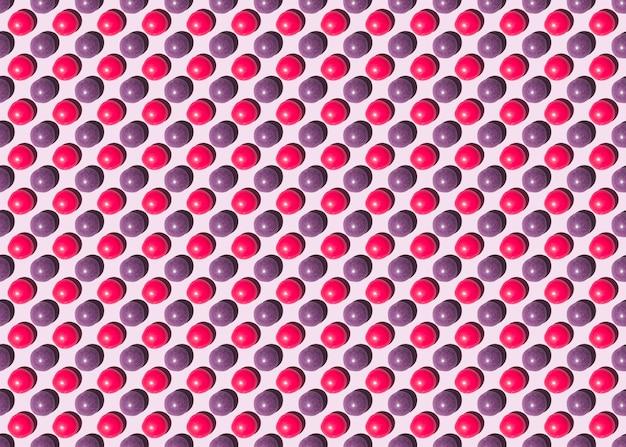 ピンクの背景に丸いお菓子のシームレスなパターン