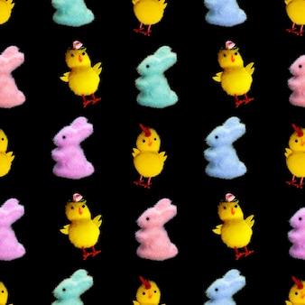 Бесшовные модели. кролики с цыплятами, изолированные на черном фоне. фото высокого качества