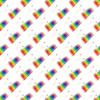 Seamless pattern of rainbow colored wooden toy 8 tone xylophone glockenspiel isolated on white