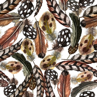 Seamless pattern of of realistic domestic and wild birds' feathers. watercolor illustration.