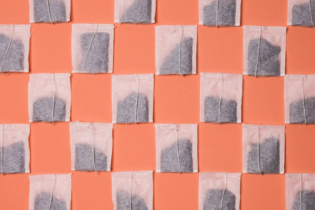 Seamless pattern on teabag on colored background