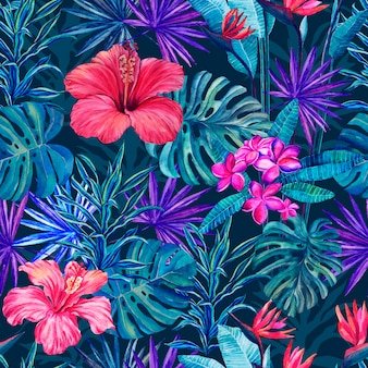Seamless pattern of tropical flowers and plants on a blue background watercolor drawing