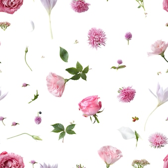 Seamless pattern of various soft flowers and leaves scattered on a white surface