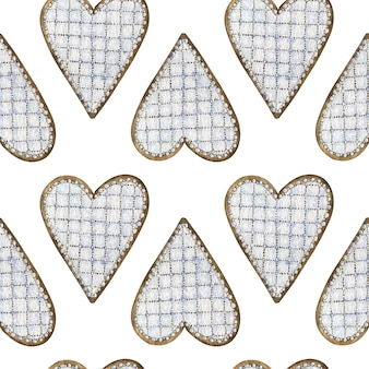Seamless pattern of watercolor heart-shaped gingerbread cookies