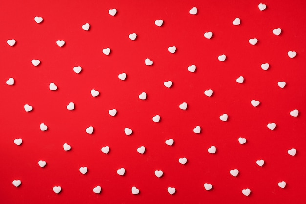 Seamless pattern. white hearts on red background. valentine's day. love, date, romantic concept.