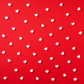 Seamless pattern. white hearts on red background. valentine's day.