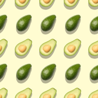 Seamless pattern with avocado on light green