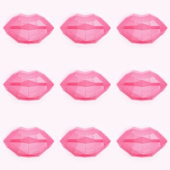 Seamless pattern with beauty pink polygonal paper lips on light pink