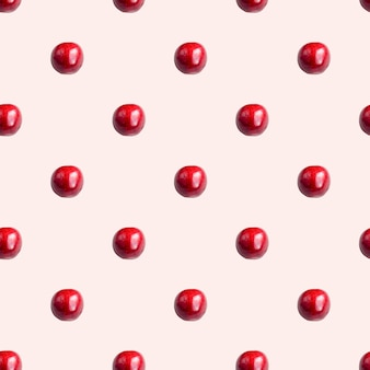 Seamless pattern with cherries on a light pink background. minimal isometric texture of food.