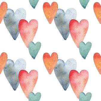 Бесшовный фон с цветными сердечками.
