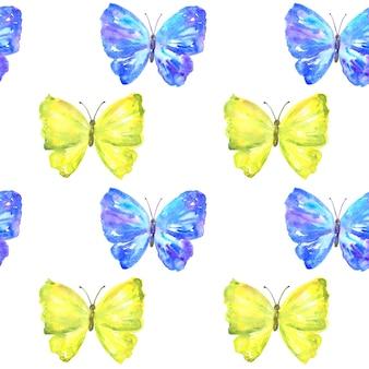 カラフルな黄色と青の蝶とのシームレスなパターン。