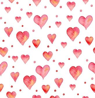 手でシームレスなパターンには、水彩心が描かれています。手描きのパターン。バレンタインデーのロマンチックな飾り。インクのイラスト。白い背景で隔離されました。ピンクと赤のハート柄