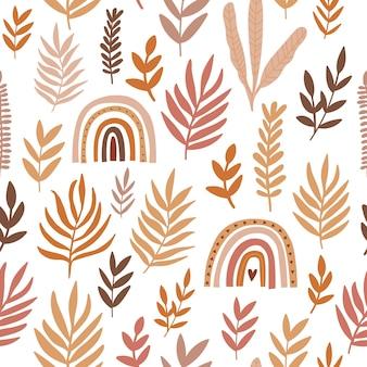 Бесшовный фон с листьями и радугой на белом фоне. осенний узор для ткани