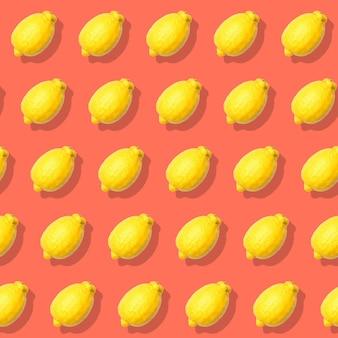 レモンとのシームレスなパターン。抽象的な赤い背景