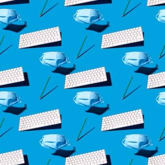 Бесшовный фон с защитной маской, клавиатурой и карандашом