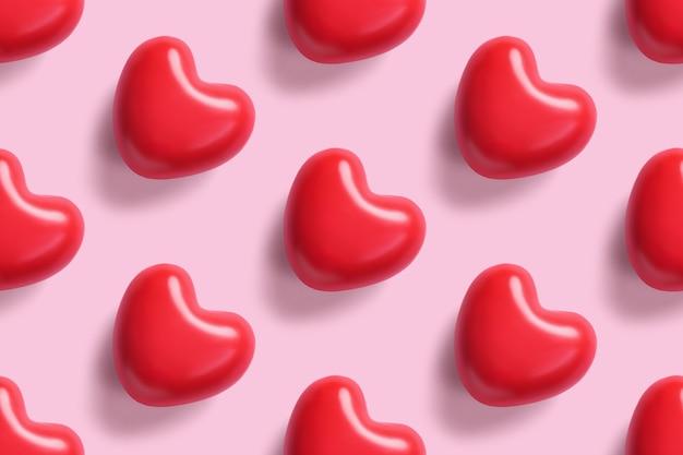 ピンクの背景に赤のシームレスなパターンが聞こえます。バレンタインデーの背景。愛の概念。
