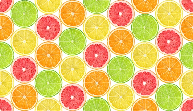 Seamless pattern with slices of citrus fruits