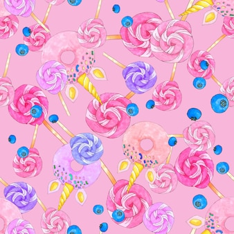 Seamless pattern with sugar candies, unicorn shaped donuts and blueberries on bright pink background.