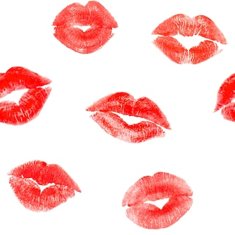 Seamless pattern with trace red lips kisses on white surface