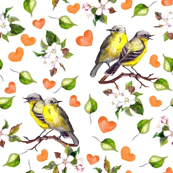 Seamless pattern with two birds on floral branch, hearts