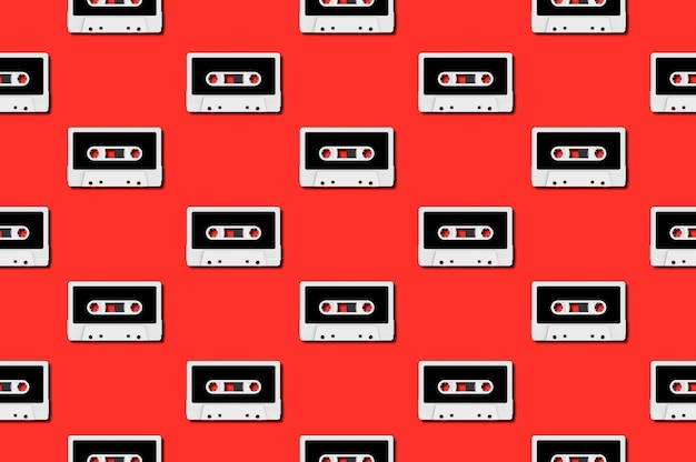 Seamless pattern with vintage white audio tape cassette concept