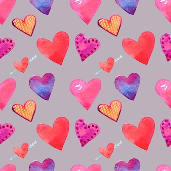 Seamless pattern with watercolor drawings. hand-drawn hearts of different sizes and colors on a gray background.